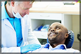 Dentist Checking a Male Patient Before Root Canal Treatment