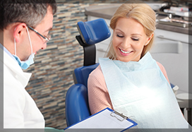 female patient at dentist in ottawa for root canal