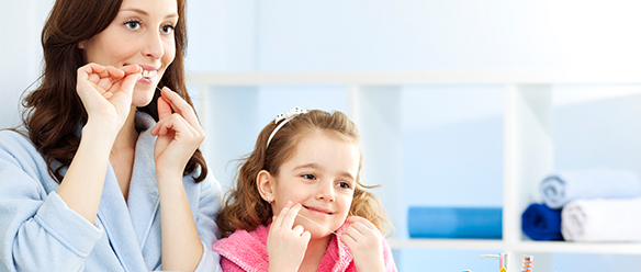 how to teach your kids to floss featured